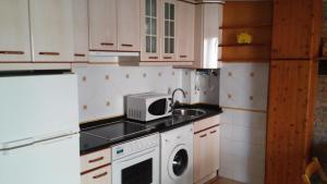 Una cocina o zona de cocina en Casa Ana Mari II