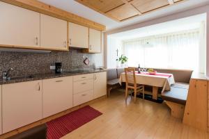 A kitchen or kitchenette at Appartamenti Genziana