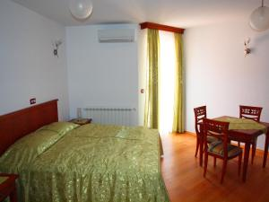 A bed or beds in a room at Villa Armin