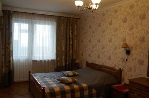 A bed or beds in a room at New Apartment on Poznyaki