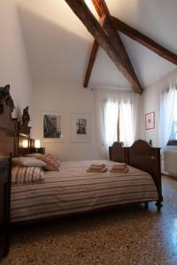 A bed or beds in a room at Ve-nice Suite Giuffa C4834