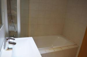 A bathroom at Rose Garden City Apartment