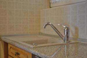 A kitchen or kitchenette at Rose Garden City Apartment
