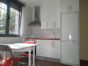 A kitchen or kitchenette at Apartamento Cuatro Torres