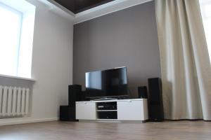 Телевизор и/или развлекательный центр в Apartment Tsentr Mir