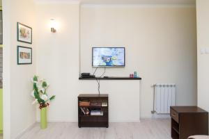 TV i/ili multimedijalni sistem u objektu Apartment Champagne
