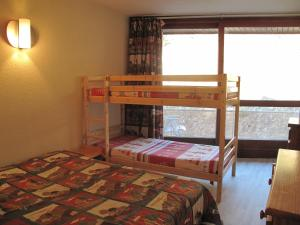 A bunk bed or bunk beds in a room at Le Balcon De Villard