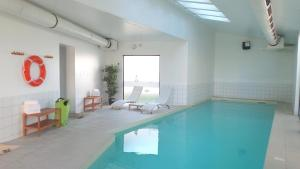 The swimming pool at or near Aparthotel Adagio Access Saint Louis Bâle