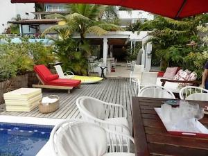The swimming pool at or near Casa Grande em Angra