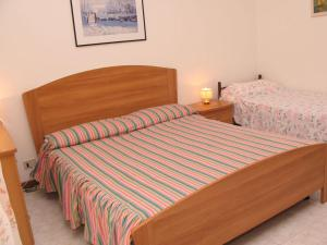 A bed or beds in a room at Villa Laura