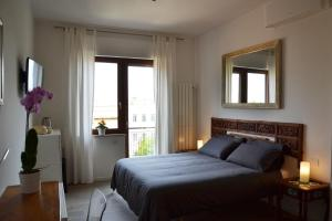 A bed or beds in a room at Studio Cardello Colosseum
