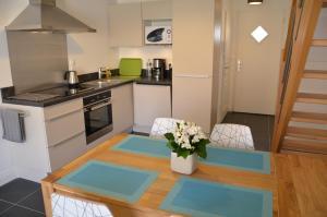 Cuisine ou kitchenette dans l'établissement Gite Opaline