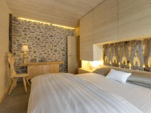 A bed or beds in a room at Chalet Edelweiss One