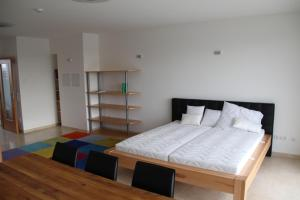A bed or beds in a room at Danube Apartment with City View