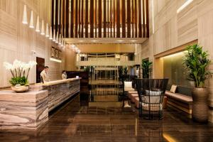A restaurant or other place to eat at Capital Centre Arjaan by Rotana