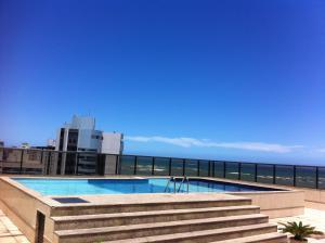 Kolam renang di atau dekat dengan Flat Ed Praia Dourada