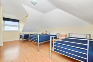 A bed or beds in a room at Access Shepherd's Bush