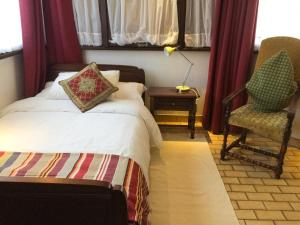 A bed or beds in a room at B&B Alexis