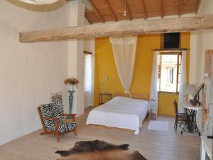 Un ou plusieurs lits dans un hébergement de l'établissement Holiday home Le Coin