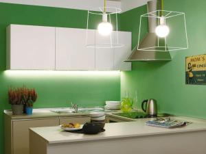 Küche/Küchenzeile in der Unterkunft Le Tre Madame
