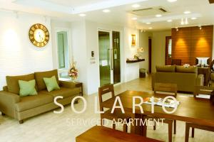 The lounge or bar area at Solario Serviced Apartment