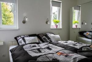 En eller flere senge i et værelse på BerLietz