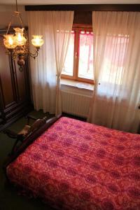 Discover Italy tesisinde bir odada yatak veya yataklar