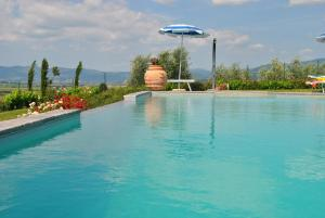 The swimming pool at or near Corte Delle Stelle