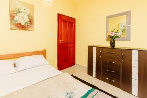 A bed or beds in a room at Bigova Sea Views Apartments