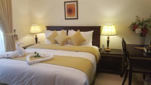 Łóżko lub łóżka w pokoju w obiekcie Al Hayat Hotel Apartments