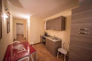 Virtuve vai virtuves aprīkojums naktsmītnē Appartamento I Fraticelli