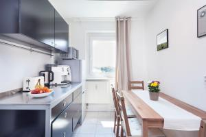 A kitchen or kitchenette at GreatStay Apartment - Stralauer Allee