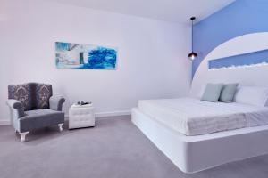A bed or beds in a room at Orabel Suites Santorini