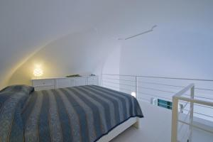 A bed or beds in a room at Appartamento Giunone