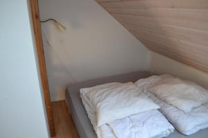 A bed or beds in a room at Nørager Apartments
