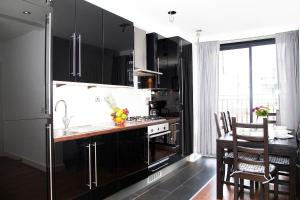 A kitchen or kitchenette at Privilege Apartments
