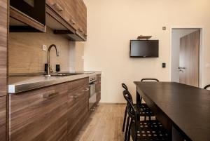 A kitchen or kitchenette at Empedocle Comfort Suite Superior
