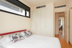 A bed or beds in a room at Apartment Olympic Village