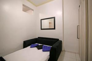 Säng eller sängar i ett rum på Copa´s Apartment
