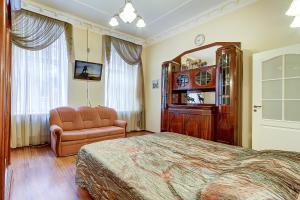 Кровать или кровати в номере Apartment Vosstaniya 42