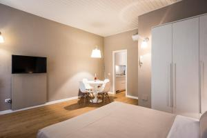 A bed or beds in a room at MyPlace Duomo Apartments