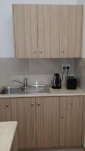 Kuhinja oz. manjša kuhinja v nastanitvi Simos Magic Apartments 1