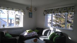 A seating area at Brúnalaug Guesthouse - Holiday Home