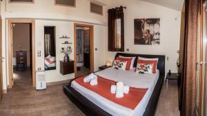 Ένα ή περισσότερα κρεβάτια σε δωμάτιο στο Villa Tasos