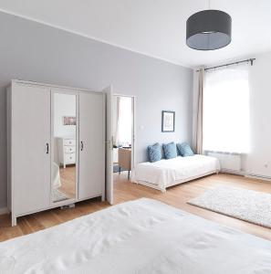 A bed or beds in a room at Badstraße Apartments