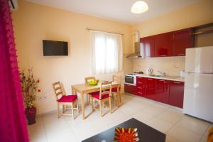 A kitchen or kitchenette at Santa Maria Luxury Apartments