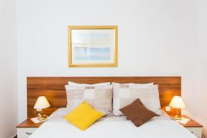 Cama o camas de una habitación en Apartments Gravosa