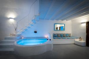 A bathroom at Fira White Residence