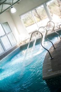 The swimming pool at or near Complejo Vacacional Coovaeco