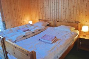 A bed or beds in a room at Myrtilles 25
